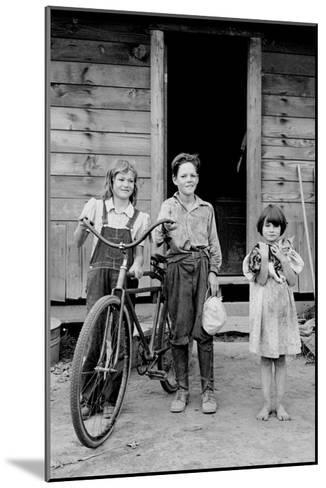 Beautiful Children with Bike and a Cat-Dorothea Lange-Mounted Art Print
