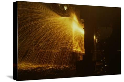 Welder's Torch Has Sparks Fly on Locomotive Factory Floor--Stretched Canvas Print