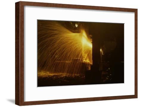 Welder's Torch Has Sparks Fly on Locomotive Factory Floor--Framed Art Print