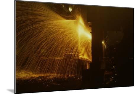 Welder's Torch Has Sparks Fly on Locomotive Factory Floor--Mounted Art Print