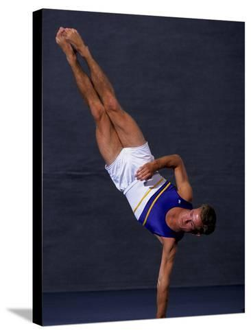 Male Gymnast Performing on the Floor Exercise--Stretched Canvas Print