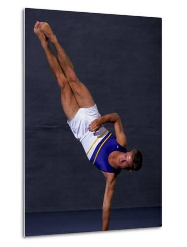 Male Gymnast Performing on the Floor Exercise--Metal Print