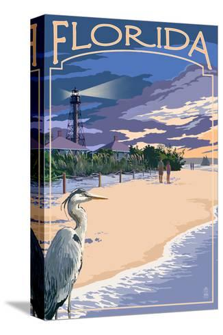 Florida - Lighthouse and Blue Heron Sunset-Lantern Press-Stretched Canvas Print