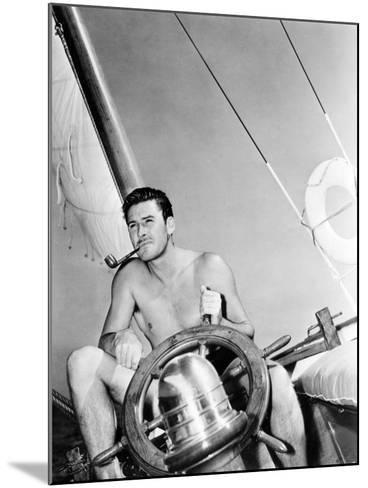 Errol Flynn Relaxing on His Yacht, October 20, 1937--Mounted Photo