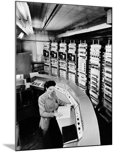 Female Operator at the Console of the 'Raydac', Raytheon Digital Automatic Computer, August 2, 1952--Mounted Photo
