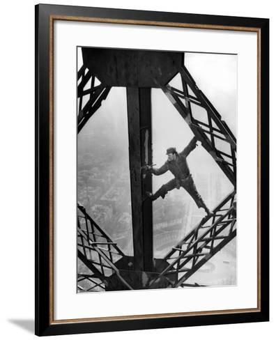Worker Painting the Eiffel Tower--Framed Art Print