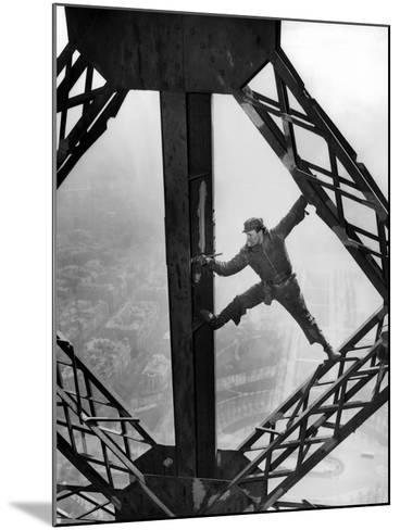 Worker Painting the Eiffel Tower--Mounted Photo