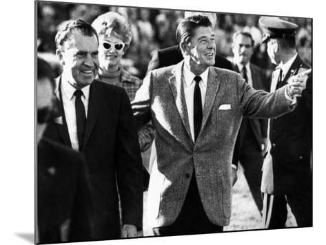 Calif Gov Ronald Reagan Escorts Pres-Elect Richard Nixon across Field at Halftime of Rose Bowl Game--Mounted Photo