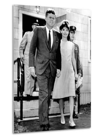 Pres and Jacqueline Kennedy Walk Hand-In-Hand after Death of Infant Son, Patrick Bouvier Kennedy--Metal Print
