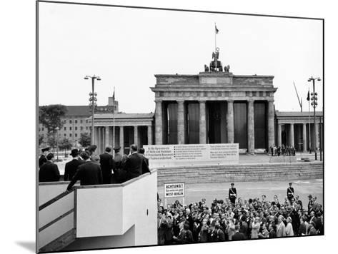 President John Kennedy Visits the Berlin Wall--Mounted Photo