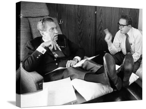 President Richard Nixon and Henry Kissinger Talking on Air Force One--Stretched Canvas Print