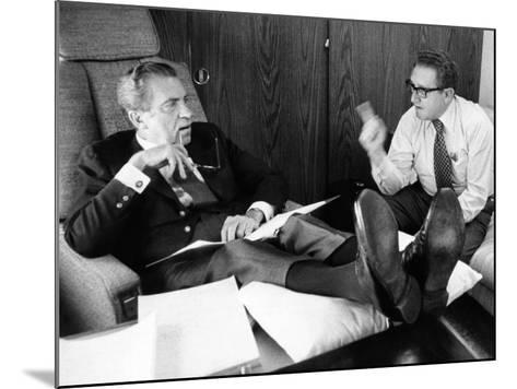 President Richard Nixon and Henry Kissinger Talking on Air Force One--Mounted Photo