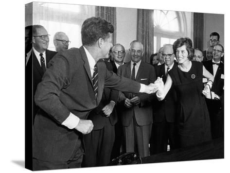 Eunice Shriver Receives a Signing Pen from Her Brother, President John Kennedy--Stretched Canvas Print