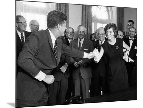 Eunice Shriver Receives a Signing Pen from Her Brother, President John Kennedy--Mounted Photo