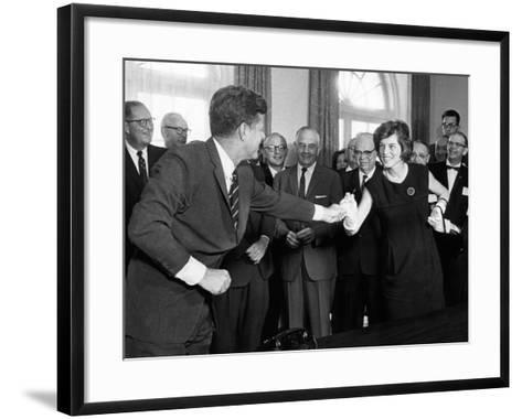 Eunice Shriver Receives a Signing Pen from Her Brother, President John Kennedy--Framed Art Print