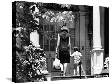 Jacqueline Kennedy and Her Son, 3 Year Old John F, Kennedy Jr Entering Georgetown Federal Era Home--Stretched Canvas Print