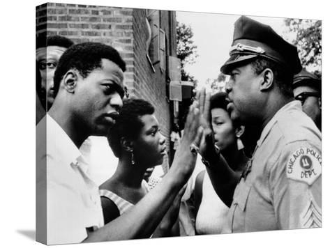Chicago African American Policeman Tries to Calm a Crowd--Stretched Canvas Print
