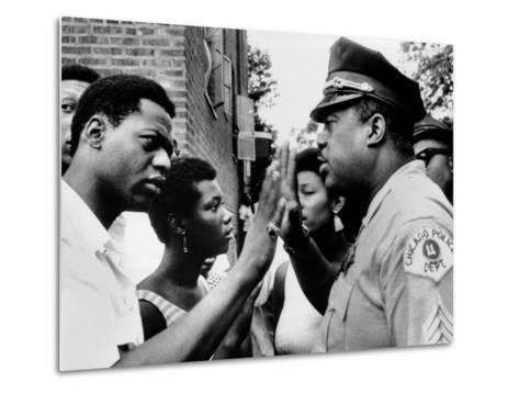 Chicago African American Policeman Tries to Calm a Crowd--Metal Print