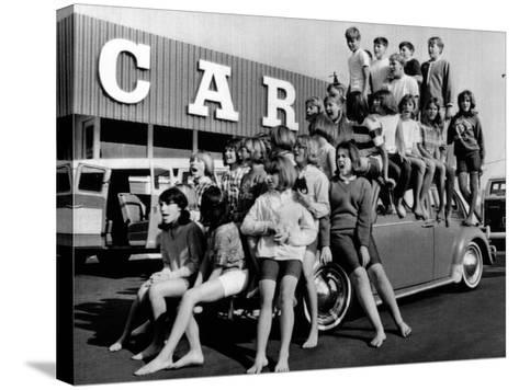 Teenagers Would Attempt to Get This Crowd into a Volkswagen Beetle--Stretched Canvas Print