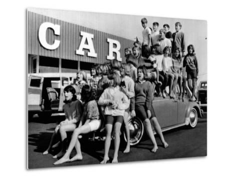 Teenagers Would Attempt to Get This Crowd into a Volkswagen Beetle--Metal Print