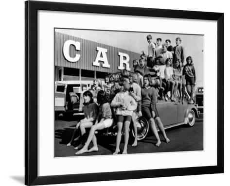Teenagers Would Attempt to Get This Crowd into a Volkswagen Beetle--Framed Art Print
