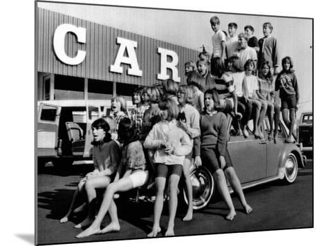 Teenagers Would Attempt to Get This Crowd into a Volkswagen Beetle--Mounted Photo