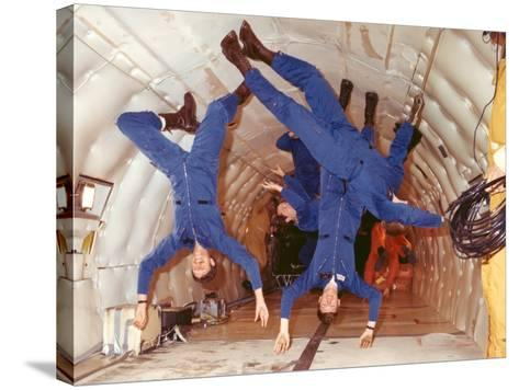 Space Shuttle Astronauts in Zero Gravity Training--Stretched Canvas Print