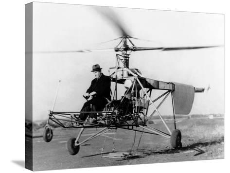 Igor Sikorsky at the Controls of the VS-300 Helicopter--Stretched Canvas Print