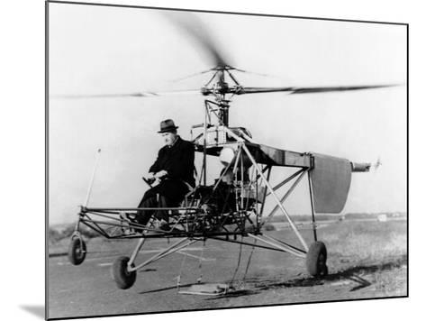Igor Sikorsky at the Controls of the VS-300 Helicopter--Mounted Photo