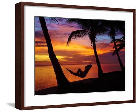 Woman in Hammock, and Palm Trees at Sunset, Coral Coast, Viti Levu, Fiji, South Pacific-David Wall-Framed Art Print