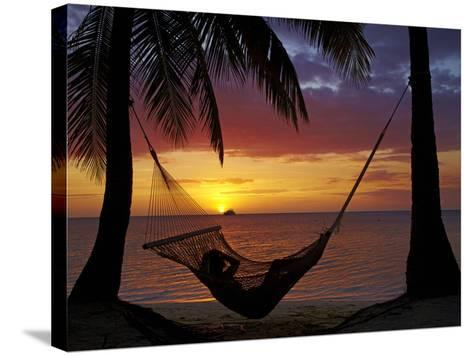 Hammock and Sunset, Plantation Island Resort, Malolo Lailai Island, Mamanuca Islands, Fiji-David Wall-Stretched Canvas Print