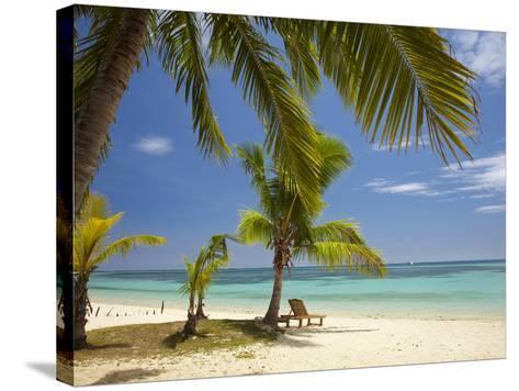 Beach and Lounger, Plantation Island Resort, Malolo Lailai Island, Mamanuca Islands, Fiji-David Wall-Stretched Canvas Print