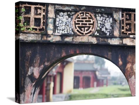 Carved Arch Inside the Imperial Palace, in Hue, Vietnam-David H^ Wells-Stretched Canvas Print