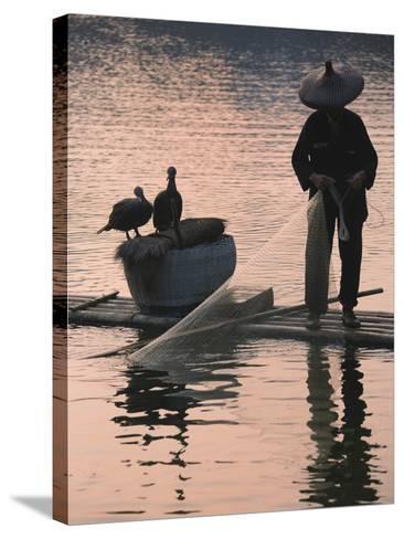 Fisherman Fishing with Cormorants on Bamboo Raft on Li River at Dusk, Yangshuo, Guangxi, China-Keren Su-Stretched Canvas Print