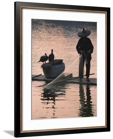 Fisherman Fishing with Cormorants on Bamboo Raft on Li River at Dusk, Yangshuo, Guangxi, China-Keren Su-Framed Art Print