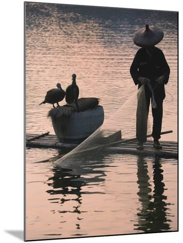 Fisherman Fishing with Cormorants on Bamboo Raft on Li River at Dusk, Yangshuo, Guangxi, China-Keren Su-Mounted Photographic Print