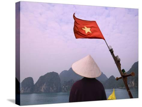 Girl with Conical Hat on a Junk Boat with National Flag and Karst Islands in Halong Bay, Vietnam-Keren Su-Stretched Canvas Print