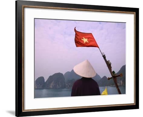 Girl with Conical Hat on a Junk Boat with National Flag and Karst Islands in Halong Bay, Vietnam-Keren Su-Framed Art Print