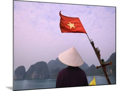 Girl with Conical Hat on a Junk Boat with National Flag and Karst Islands in Halong Bay, Vietnam-Keren Su-Mounted Photographic Print