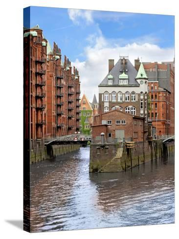 Waterfront Warehouses and Lofts in the Speicherstadt Warehouse District of Hamburg, Germany,-Miva Stock-Stretched Canvas Print