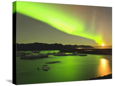 Aurora Borealis and Moon over Icebergs, Jokulsarlon and Breidamerkurjokull, Iceland-Tom Norring-Stretched Canvas Print