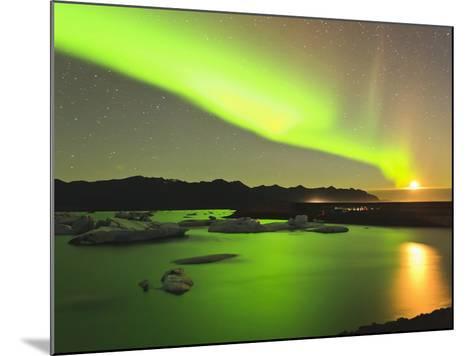 Aurora Borealis and Moon over Icebergs, Jokulsarlon and Breidamerkurjokull, Iceland-Tom Norring-Mounted Photographic Print