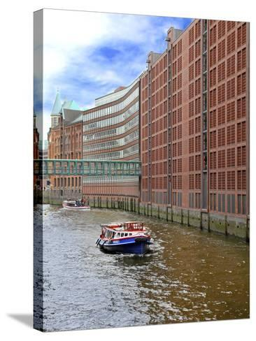 Boats Pass by Waterfront Warehouses and Lofts, Speicherstadt Warehouse District, Hamburg, Germany-Miva Stock-Stretched Canvas Print