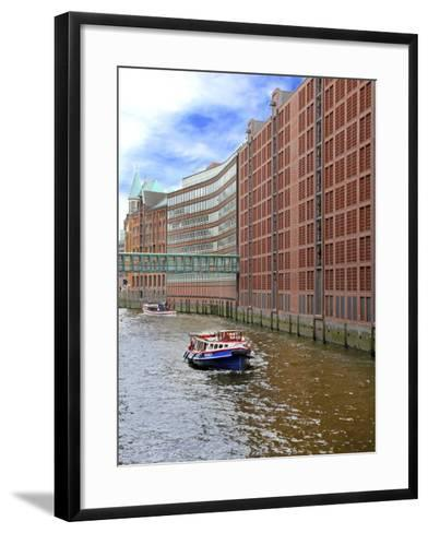 Boats Pass by Waterfront Warehouses and Lofts, Speicherstadt Warehouse District, Hamburg, Germany-Miva Stock-Framed Art Print