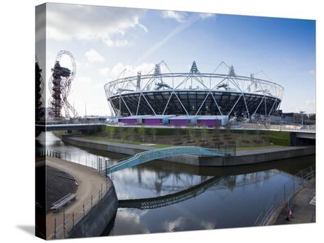 The Olympic Stadium with the Arcelor Mittal Orbit and the River Lee, London, England, UK-Mark Chivers-Stretched Canvas Print