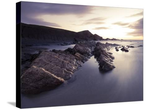 Long Exposure of Waves Moving over Rocks on Crackington Haven Beach at Sunset, Cornwall, England-Ian Egner-Stretched Canvas Print