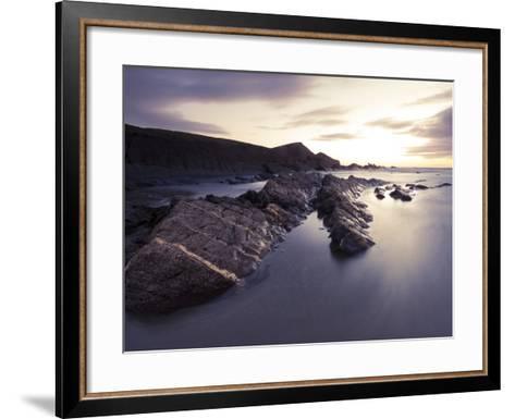 Long Exposure of Waves Moving over Rocks on Crackington Haven Beach at Sunset, Cornwall, England-Ian Egner-Framed Art Print