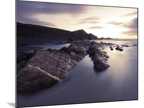 Long Exposure of Waves Moving over Rocks on Crackington Haven Beach at Sunset, Cornwall, England-Ian Egner-Mounted Photographic Print