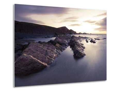Long Exposure of Waves Moving over Rocks on Crackington Haven Beach at Sunset, Cornwall, England-Ian Egner-Metal Print