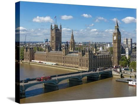 Buses Crossing Westminster Bridge by Houses of Parliament, London, England, United Kingdom, Europe-Walter Rawlings-Stretched Canvas Print